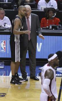 Spurs Head Coach Gregg Popovich talks to Tony Parker during a break in the action in the second half of Game 3 of the 2014 NBA Finals at the American Airlines Arena in Miami on Tuesday, June 10, 2014. (Kin Man Hui/San Antonio Express-News) Photo: Kin Man Hui, San Antonio Express-News