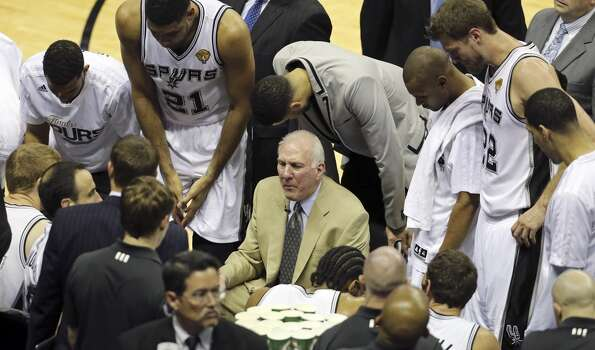 San Antonio Spurs head coach Gregg Popovich talks with the team during first half action in Game 2 of the NBA Finals against the Miami Heat Sunday June 8, 2014 at the AT&T Center. Photo: Edward A. Ornelas, San Antonio Express-News
