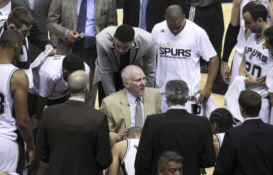 Spurs Head Coach Gregg Popovich talks to the team during a timeout in the first half of Game 2 of the 2014 NBA Finals at the AT&T Center on Sunday, June 8, 2014. (Kin Man Hui/San Antonio Express-News)