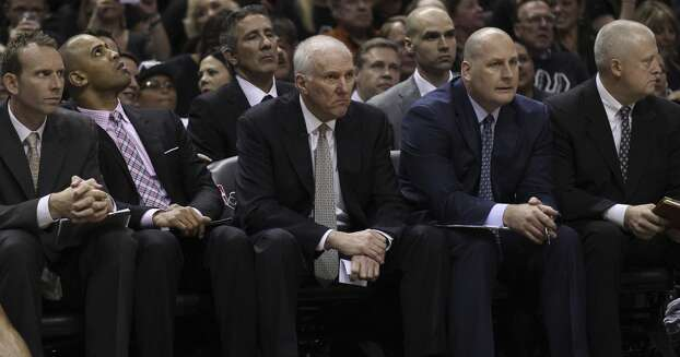 Spurs Head Coach Gregg Popovich watches the beginning of the first quarter of Game 1 between the Spurs and the Miami Heat in the 2014 NBA Finals at the AT&T Center on Thursday, June 5, 2014. Photo: Kin Man Hui, San Antonio Express-News