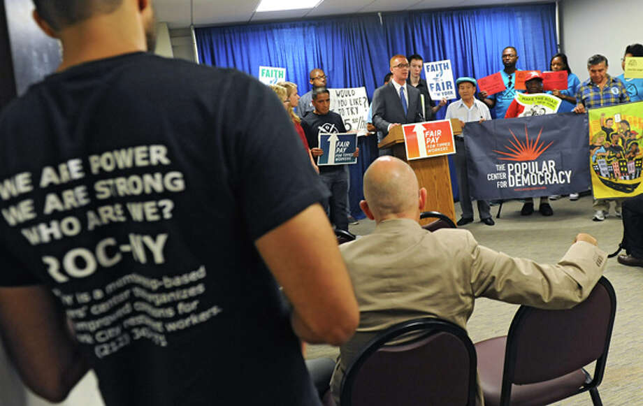 Jack Temple, policy analyst for National Employment Law Project, speaks as advocates urge Gov. Cuomo to raise the minimum wage for the state's tipped sub-minimum wage, low-wage tipped workers during a press conference at the Legislative Office Building on Wednesday, July 9, 2014 in Albany, N.Y.  (Lori Van Buren / Times Union) Photo: Lori Van Buren, Albany Times Union / 00027720A