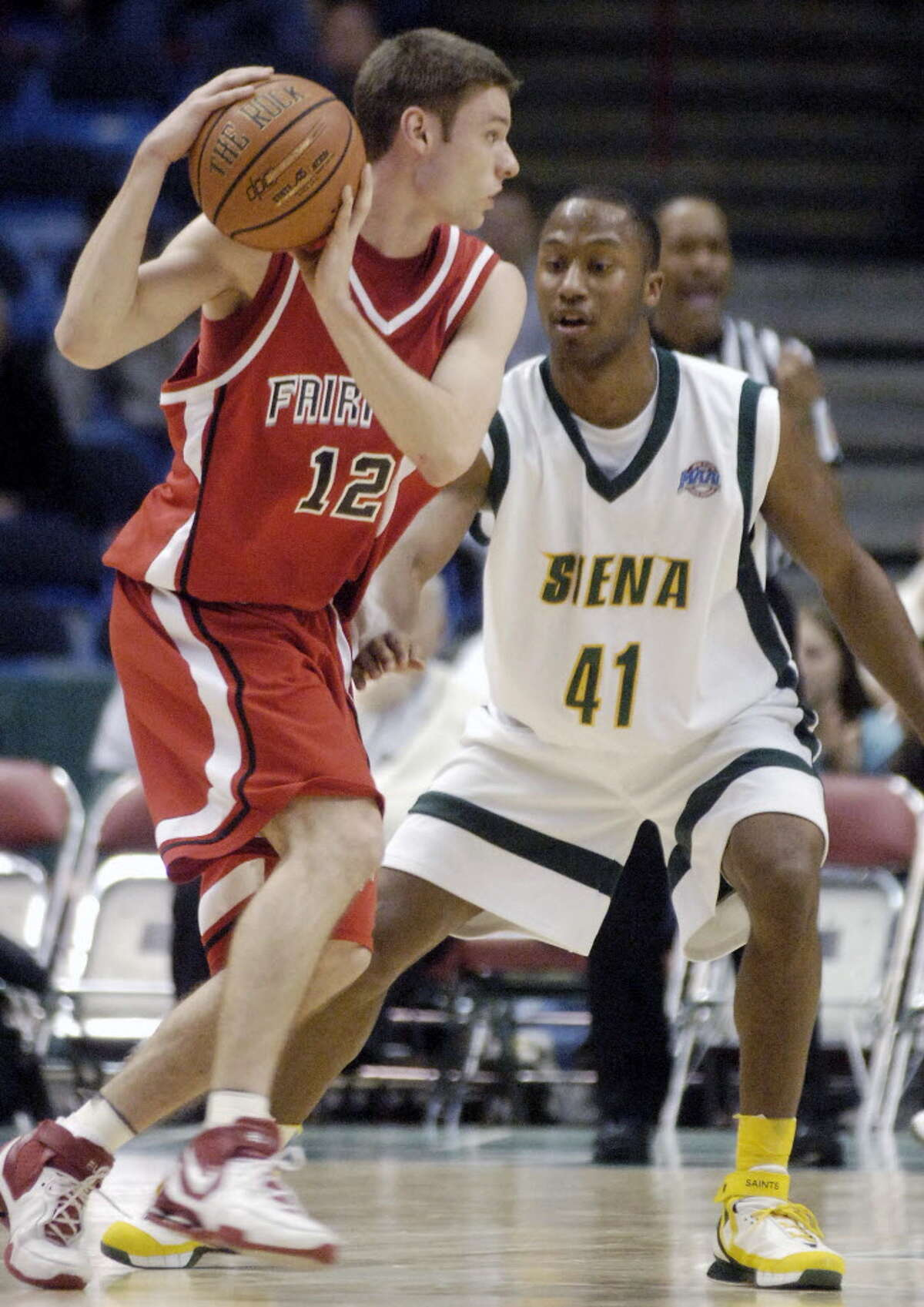 Times Union Photo by James Goolsby-Jan. 19, 2007-Fairfield #12-Michael Van Schaick, from Glens Falls N.Y. Controls the ball vs Siena #41-Kenny Hasbrouck. In the first half of game at the Times Union Center.