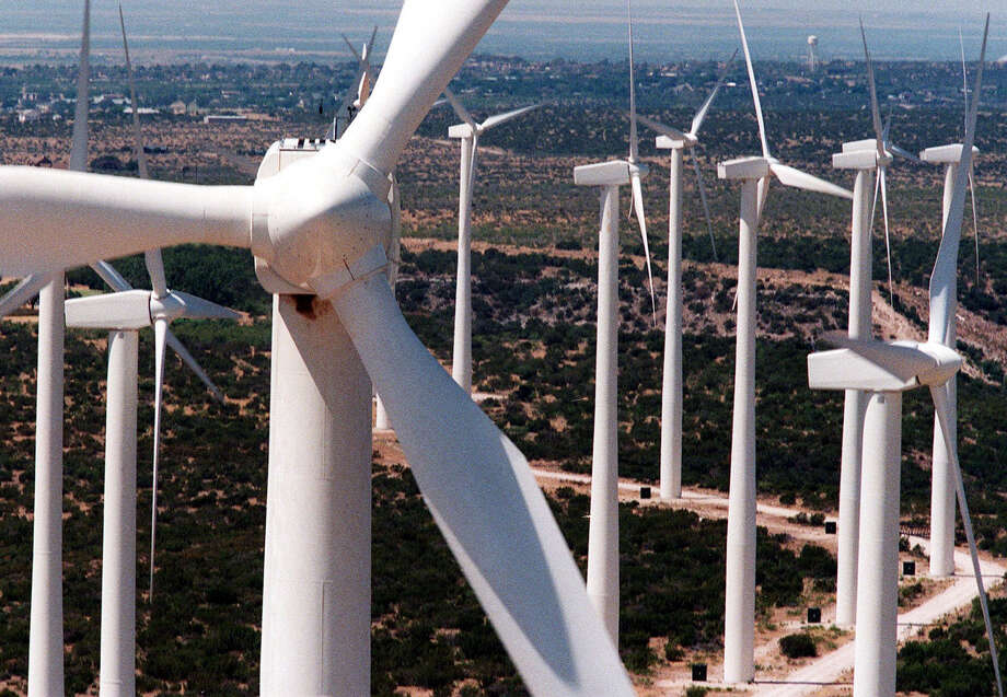 Wind turbines 25 stories tall rise from the plains of West Texas in Big Spring. Texas is one of the windiest states in the nation and the Panhandle and West Texas are the state's windiest regions. Photo: CAROLYN MARY BAUMAN, KRT / FORT WORTH STAR-TELEGRAM