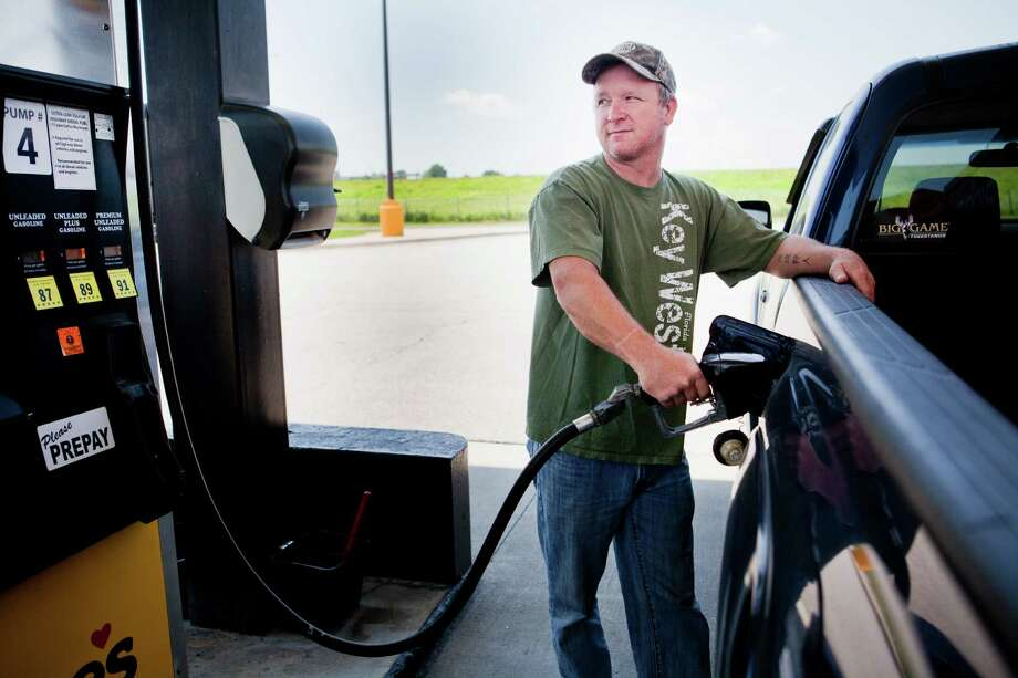 FILE - In this July 1, 2014 file photo, Lance Thompson pumps gas into his truck at a Love's station in St. Joseph, Mo. The price of oil fell for the ninth straight day Wednesday, July 9, 2014, despite continued turmoil in the Middle East, a drop that could lead to lower gasoline prices for U.S. drivers in the weeks ahead.  (AP Photo/St. Joseph News-Press, Sait Serkan Gurbuz, File) ORG XMIT: MOSTN201 Photo: Sait Serkan Gurbuz / St. Joseph News-Press