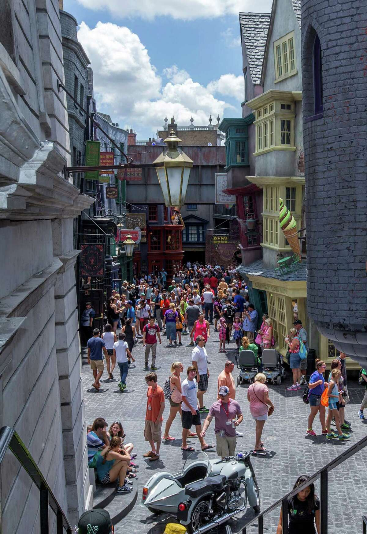 Guests visit Diagon Alley at the Wizarding World of Harry Potter at Universal Orlando, in Orlando, Fla., on Wednesday, July 9, 2014.