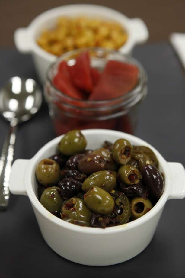 Fresh herb & chili marinated olives are part of a vegan tapas tray available to fans at the 49er's new Levi's Stadium in Santa Clara, CA, Wednesday, July 9, 2014. Photo: The Chronicle