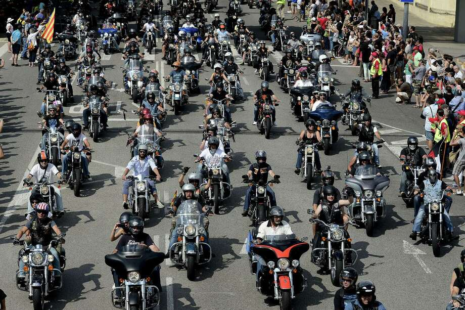 Harley-Davidson motorcyclists ride through Barcelona during Barcelona Harley Days this month. The event gathers thousands of riders from all over Europe. Photo: JOSEP LAGO, Stringer / AFP