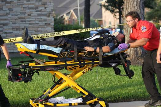 A deputy is carted away from the scene of a police standoff after suffering heat exhaustion. Police were involved in a standoff after multiple people were killed in a shooting in Spring. (Brett Coomer / Houston Chronicle)