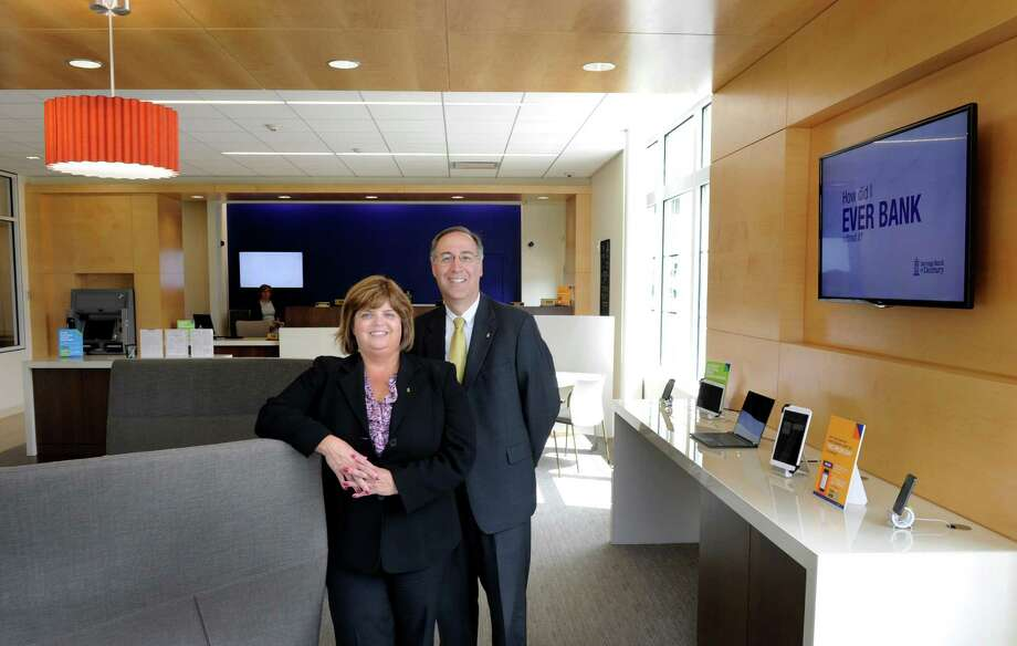 Kathleen Romagnano, 51, president and chief executive officer of Savings Bank of Danbury and Steven Cacchio, 50, executive vice president and chief operating officer, are photographed in the new branch office of Savings Bank of Danbury, 314 Danbury Road in New Milford, Conn., Wednesday, July 9, 2014. Photo: Carol Kaliff / The News-Times