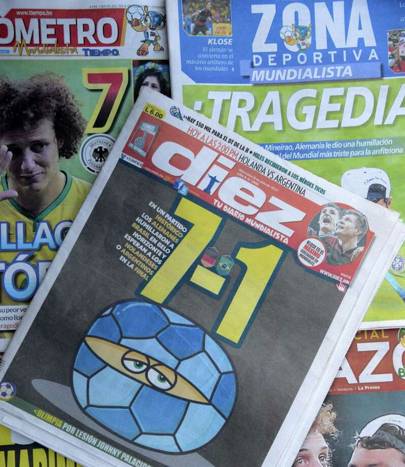 Brazilian newspapers highlighting Germany's 7-1 win over Brazil in the World Cup semifinals were a prevalent and painful reminder a day after the match. Photo: Orlando Sierra / AFP / Getty Images / AFP