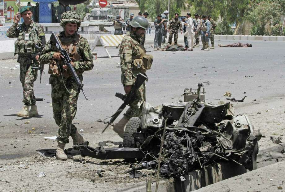 Afghan security forces inspect the site of a suicide attack in the city of Kandahar south of Kabul. Photo: Allauddin Khan / Associated Press / AP