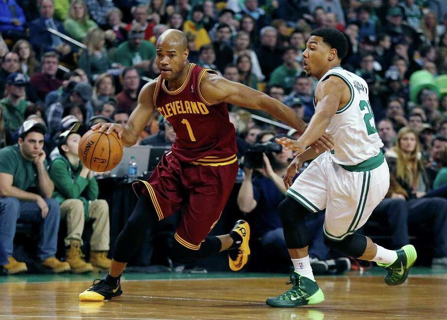 FILE - In this Dec. 28, 2013 file photo, Cleveland Cavaliers' Jarrett Jack (1) drives past Boston Celtics' Phil Pressey (26) in the second quarter of an NBA basketball game in Boston. A person familiar with the deals says the Cavaliers have agreed to trade Jack, swingman Sergey Karasev and center Tyler Zeller, moves that can help their pursuit of LeBron James by clearing salary cap space. The Cavs have agreements with the Brooklyn Nets and Boston Celtics, according to the person who spoke Wednesday, July 9, 2014, to The Associated Press. The person spoke on condition of anonymity because teams are not permitted to discuss any trades until the league's moratorium ends Thursday. (AP Photo/Michael Dwyer, File) ORG XMIT: NY154 Photo: Michael Dwyer / AP