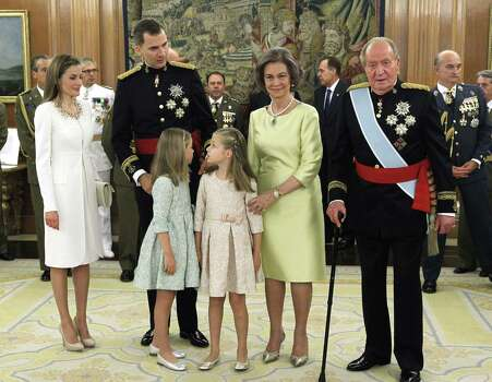 Spain's Queen Letizia, Spain's King Felipe VI, Spanish Princess Sofia, Spanish Crown Princess of Asturias Leonor, Spain's former Queen Sofia and Spain's former King Juan Carlos stand during a handing over ceremony for the sash of the Capitain General in the Chamber of Audiences at the Zarzuela Palace . Spain's King Felipe VI begins a new reign today already facing a threat to the unity of his kingdom as the northeastern region of Catalonia fights to hold an independence referendum on November 9.  AFP PHOTO / pool / ZIPIZIPI/AFP/Getty Images Photo: ZIPI, AFP/Getty Images / AFP
