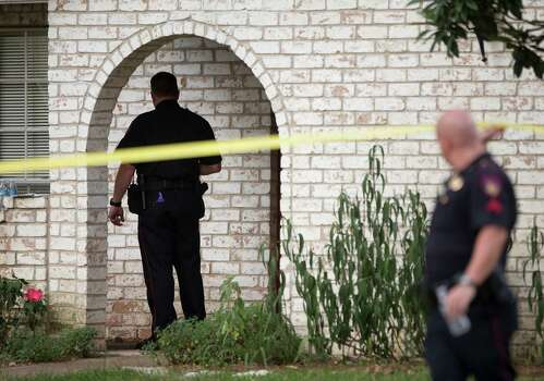 Law enforcement officers investigate the scene of a shooting Wednesday, July 9, 2014, in Spring. Seven people were shot, with six confirmed dead. Photo: Brett Coomer, Houston Chronicle / © 2014 Houston Chronicle