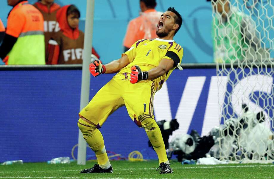 Argentina's goalkeeper Sergio Romero celebrates after he saved shot by Netherlands' Wesley Sneijder from the spot during the World Cup semifinal soccer match between the Netherlands and Argentina at the Itaquerao Stadium in Sao Paulo, Brazil, Wednesday, July 9, 2014. Argentina beat the Netherlands 4-2 in a penalty shootout to reach the World Cup final. (AP Photo/Frank Augstein) ORG XMIT: WCFO149 Photo: Frank Augstein / AP