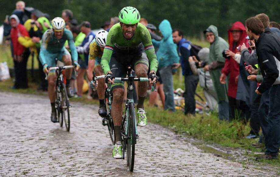 """Lars Boom of the Netherlands navigated the cobblestone roads and rain Wednesday to claim the fifth stage of the Tour de France. """"This is a special, special day for me,"""" he said. Photo: Doug Pensinger / Getty Images / 2014 Getty Images"""