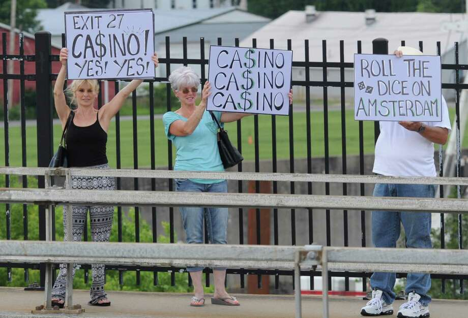 Pro casino supporters protesters wave signs at passing cars on Route 30 Wednesday July 9, 2014 in Amsterdam, N.Y. (Michael P. Farrell/Times Union) Photo: Michael P. Farrell / 00027715A