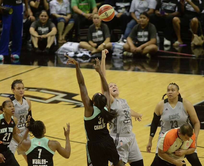 Tina Charles (31) of the New York Liberty and Jayne Appel of the San Antonio Stars compete for a jump ball to start their WNBA game in the AT&T Center on Wednesday, July 9, 2014.