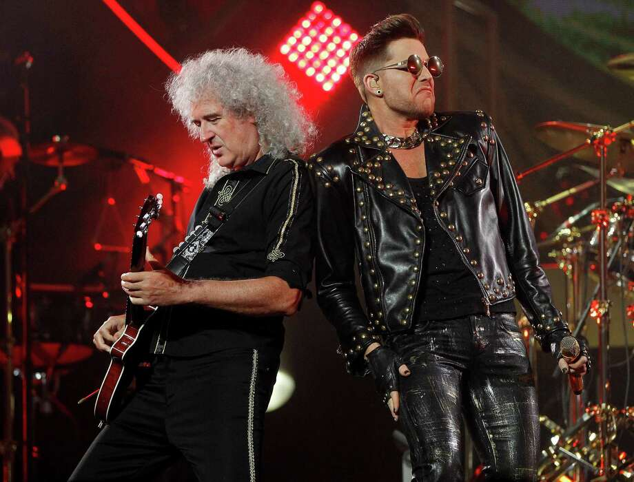 Guitarist Brian May stands next to Adam Lambert as Queen performs at the Toyota Center, Wednesday, July 9, 2014, in Houston. Photo: Karen Warren, Houston Chronicle / © 2014 Houston Chronicle