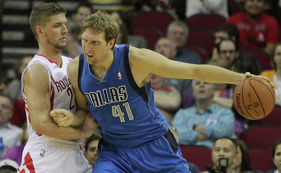 Unless the Rockets match the offer sheet Chandler Parsons, left, received from Dallas on Wednesday, Parsons will be playing alongside Dirk Nowitzski (41) next season instead of against the Mavericks veteran. Photo: James Nielsen, Staff / © 2013  Houston Chronicle