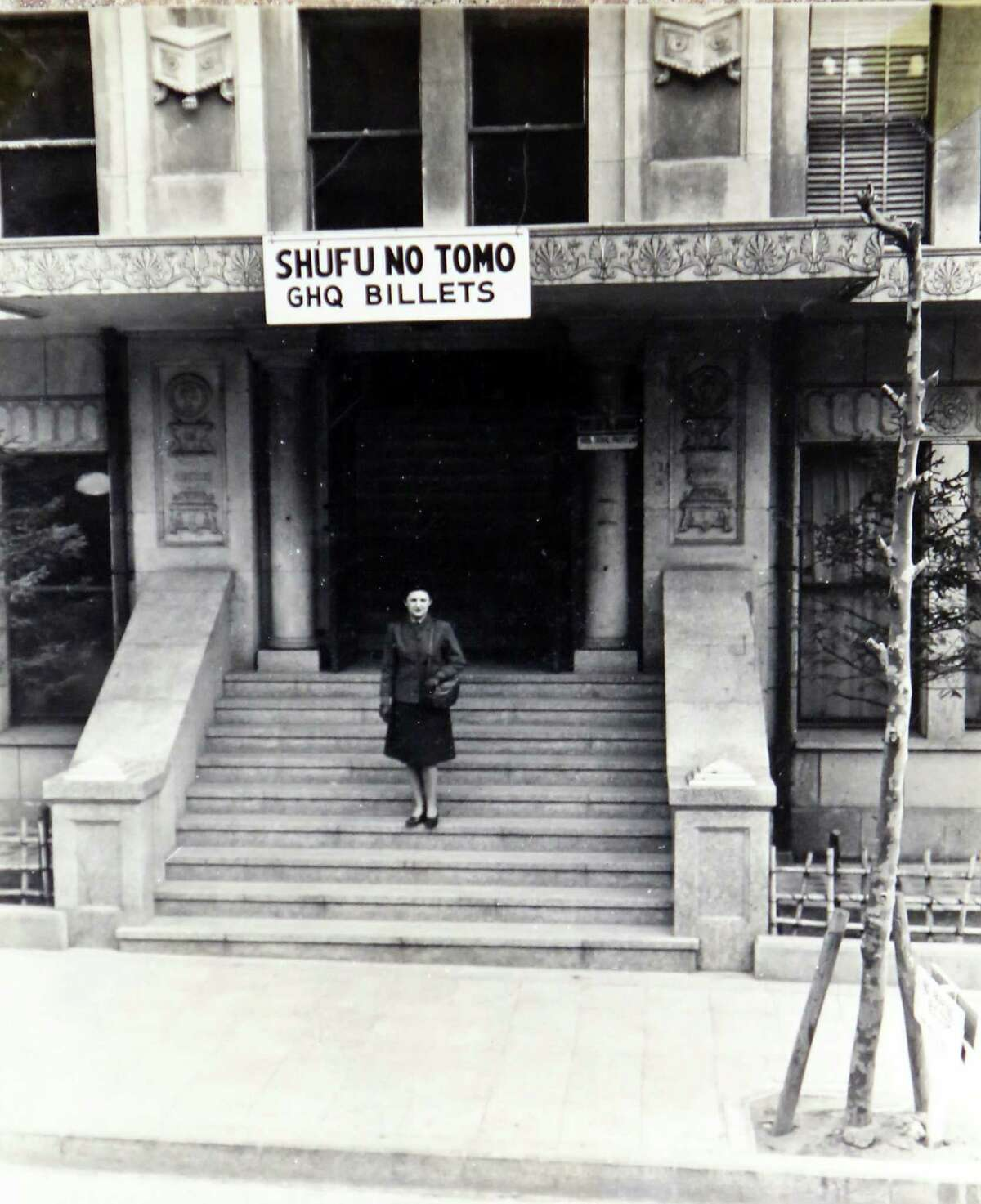 Lucy Coffey stands on the steps of her residence while she lived in Okinawa. Coffey is the nationØs oldest woman veteran, serving in the procurement office of the WomenØs Army Auxiliary Corps during World War II. Today, she is 108 years old and failing. A group in Austin wants to send her to Washington for an honor flight and possibly meet with Vice President Biden. Coffey enlisted in the Women's Army Auxiliary Corps in 1943 and landed in Japan, where she served in the procurement office and worked for 10 years after the war ended. She worked in the procurement office at Kelly from 1958 until her retirement in 1971, and is only a few days younger than AmericaØs oldest male veteran, Richard Overton.