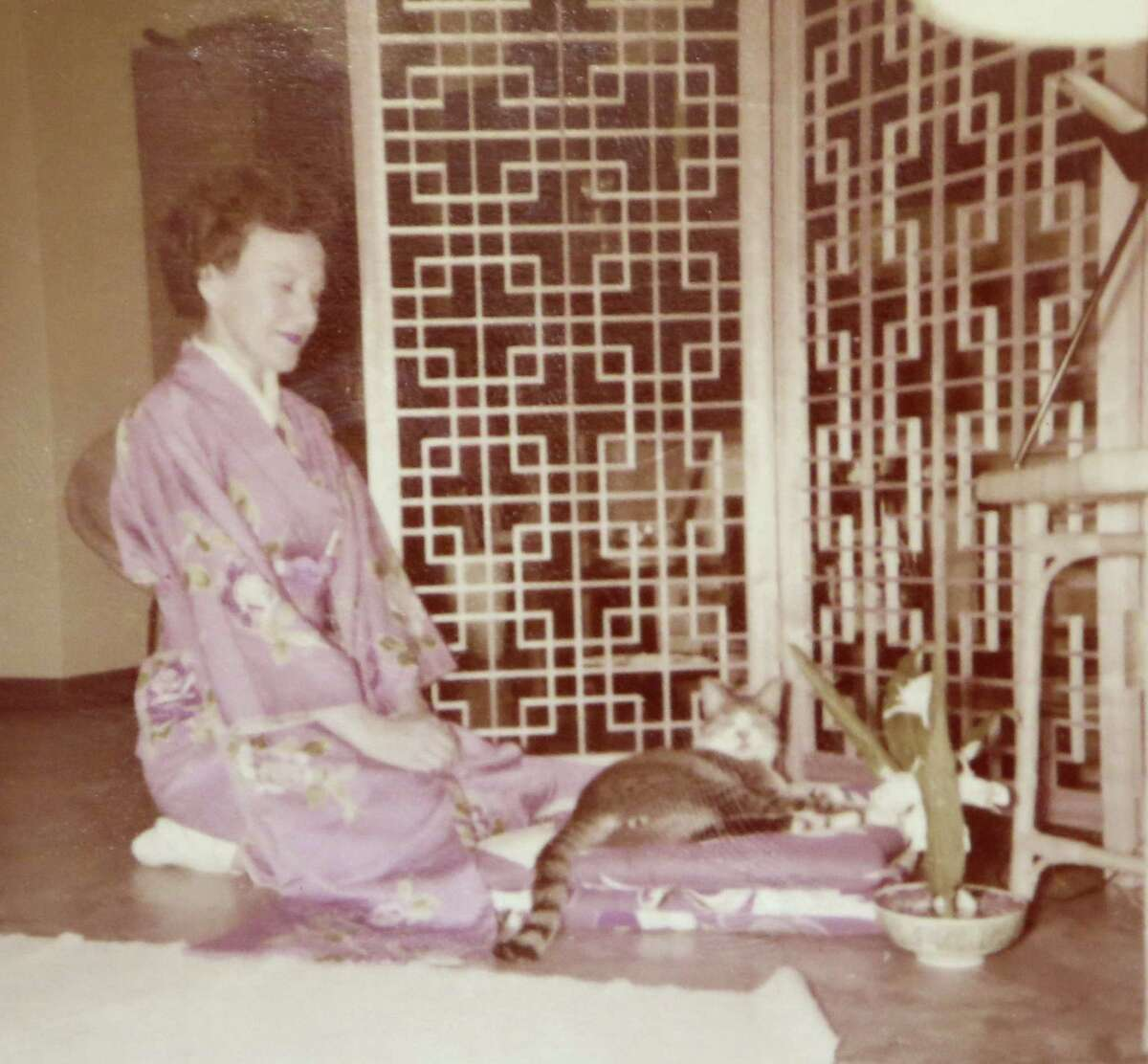 Lucy Coffey, along with her cat Buster in Okinawa. Coffey the nation's oldest woman veteran, served in the procurement office of the Women's Army Auxiliary Corps during World War II. A group in Austin wants to send her to Washington for an honor flight.