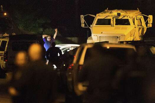 A shooting suspect surrenders to law enforcement officers after 4-hour standoff on Wednesday, July 9, 2014, in Spring. The suspect is believed to have shot seven people, with a number of fatalities reported. Photo: Brett Coomer, Houston Chronicle / © 2014 Houston Chronicle