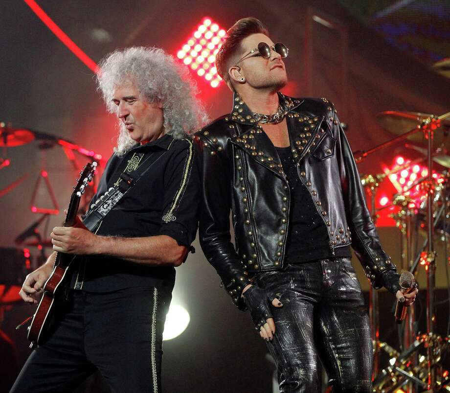 Guitarist Brian May and Adam Lambert led Queen in performance at the Toyota Center on Wednesday night.  Lambert brought his own style to Queen's hits while staying true to the original versions. Photo: Karen Warren, Staff / © 2014 Houston Chronicle