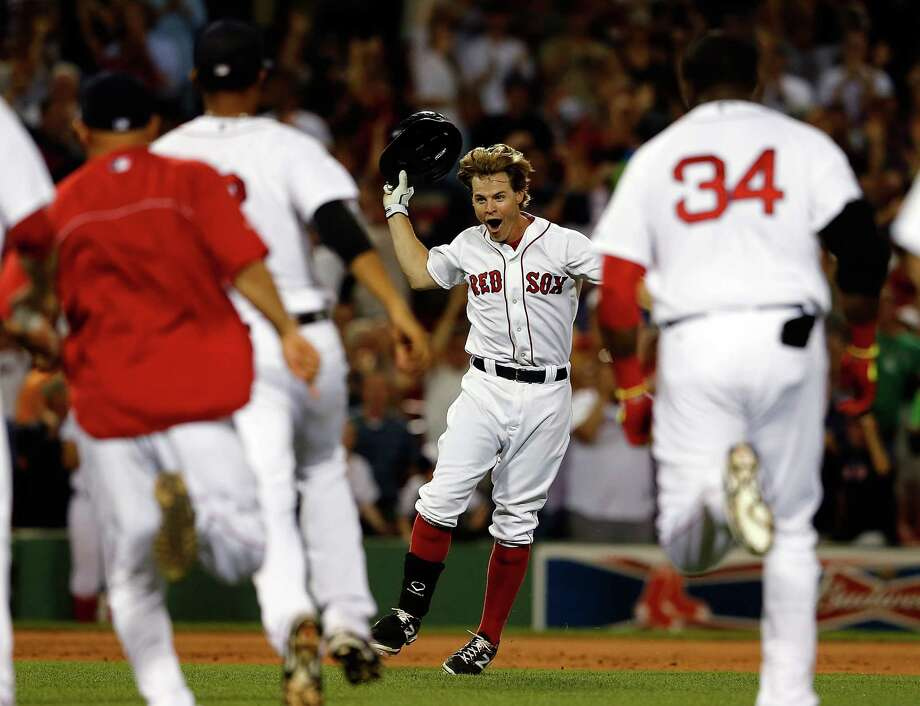 BOSTON, MA - JULY 9:  Brock Holt #26 of the Boston Red Sox reacts after knocking in the winning run in the ninth inning against the Chicago White Sox at Fenway Park on July 9, 2014 in Boston, Massachusetts.  (Photo by Jim Rogash/Getty Images) ORG XMIT: 477586189 Photo: Jim Rogash / 2014 Getty Images