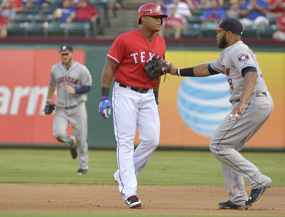 The Rangers' Adrian Beltre gave Texas the early lead Wednesday with an RBI single in the first inning, but he was caught between bases by Astros first baseman Jon Singleton to put an end to any further threat. Photo: Max Faulkner, MBR / Fort Worth Star-Telegram