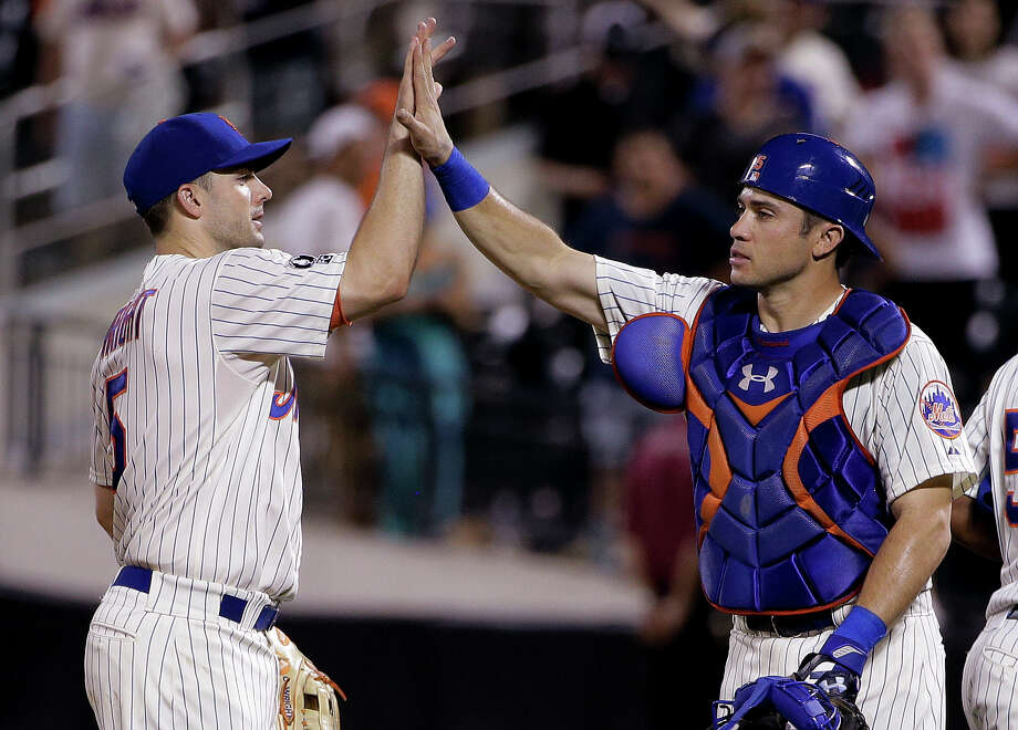 New York Mets' David Wright (5) high fives catcher Travis d'Arnaud (15) at the end of a baseball game against the Atlanta Braves, Wednesday, July 9, 2014, in New York. The Mets won 4-1. (AP Photo/Julie Jacobson) ORG XMIT: NYJJ119 Photo: Julie Jacobson / AP