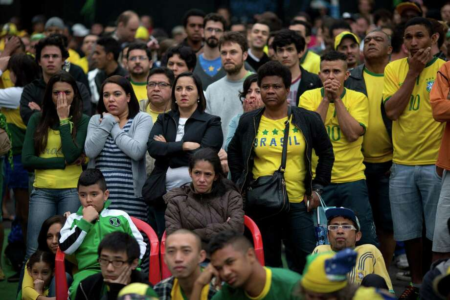 National mourning begins for Brazilian fans during a public viewing of Tuesday's 7-1 loss to Germany. Photo: Rodrigo Abd, STF / AP