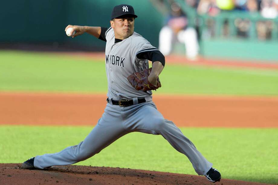 CLEVELAND, OH - JULY 8: Starting pitcher Masahiro Tanaka #19 of the New York Yankees pitches during the first inning against the Cleveland Indians at Progressive Field on July 8, 2014 in Cleveland, Ohio.  (Photo by Jason Miller/Getty Images) ORG XMIT: 477586149 Photo: Jason Miller / 2014 Getty Images