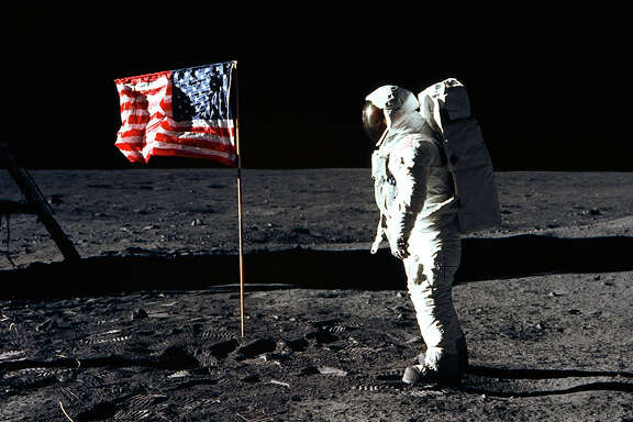 Astronaut Buzz Aldrin, lunar module pilot of the first lunar landing mission, poses for a photograph beside the deployed United States flag during Apollo 11 on July 20, 1969.  Astronaut Neil Armstrong took the photograph.