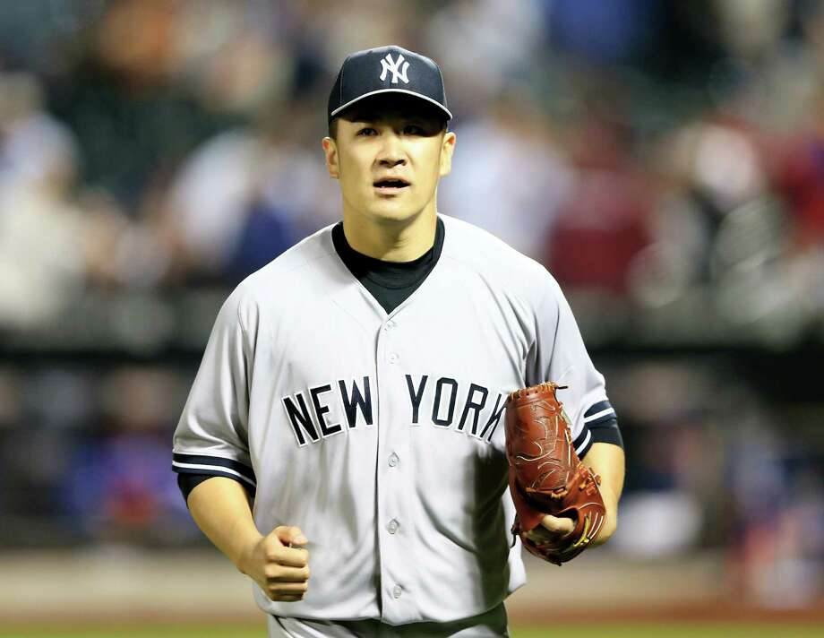 NEW YORK, NY - MAY 14:  Masahiro Tanaka #19 of the New York Yankees celebrates as he walks off the field in the eighth inning against the New York Mets during interleague play on May 14, 2014 at Citi Field in the Flushing neighborhood of the Queens borough of New York City.  (Photo by Elsa/Getty Images) Photo: Elsa, Staff / 2014 Getty Images