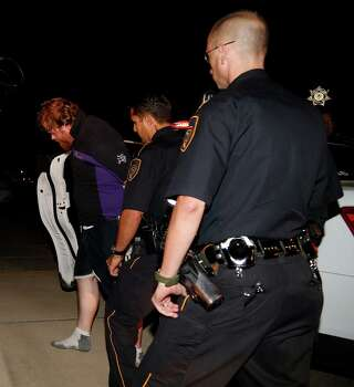 Harris County Sheriffs unload the suspect wanted in the Spring area shooting deaths of six family members at the Lockwood facility, Wednesday, July 9, 2014, in Houston, as detectives wait to interview the suspect. Photo: Karen Warren, Houston Chronicle / © 2014 Houston Chronicle