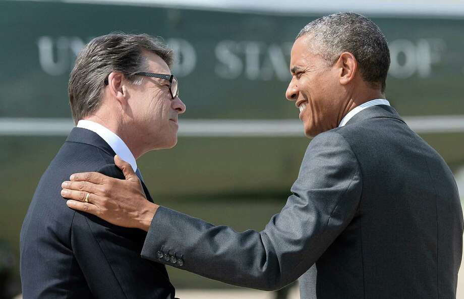 President Barack Obama is greeted by Gov. Rick Perry as he arrives in Dallas for a meeting on the border crisis. Photo: JEWEL SAMAD, AFP/Getty Images / AFP