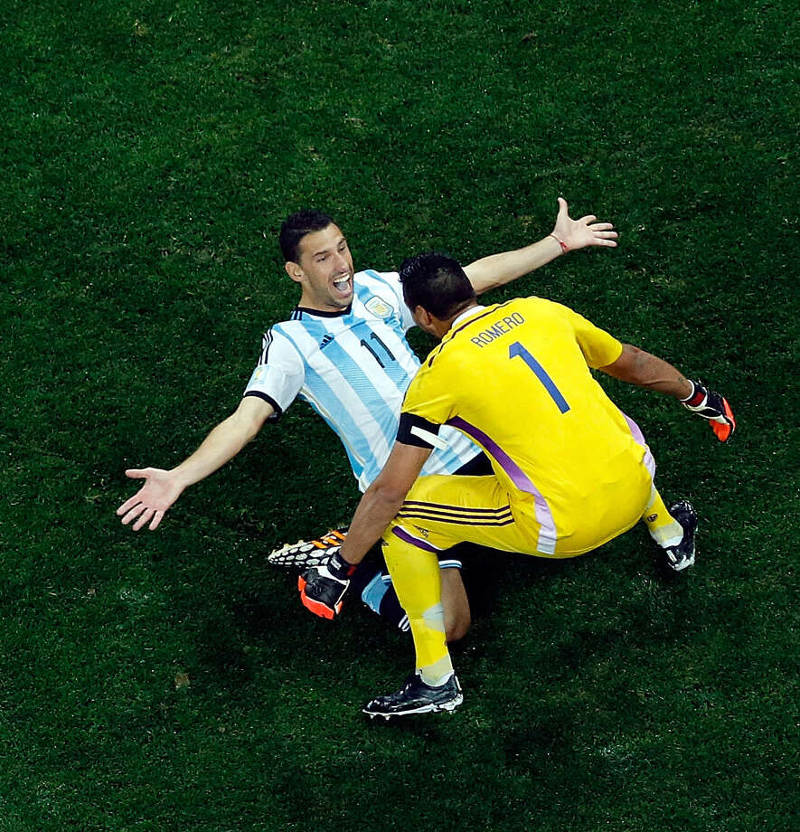 Maxi Rodriguez and keeper Sergio Romero congratulate each other after helping Argentina reach its first final in 24 years. Photo: Fabrizio Bensch / Getty Images / 2014 Getty Images