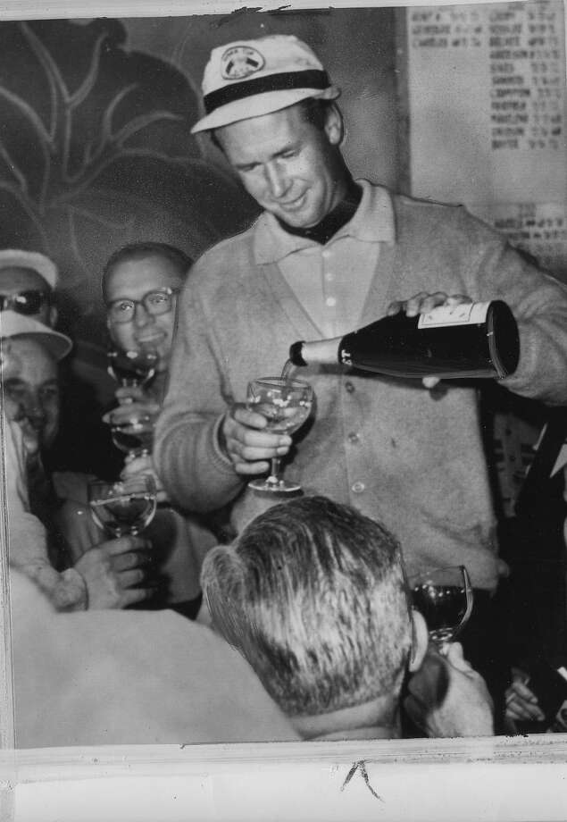 Tony Lema pours champagne for reporters after winning the Bing Crosby Pro-Am at Pebble Beach 01/19/1964 UPI photo   Photo ran 01/20/1964 P. 47 Photo: The Chronicle