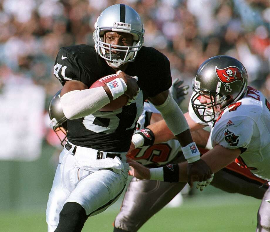Tim Brown, Raiders                        Season: 1999       Age: 33           Catches: 90           Yards: 1,344               Touchdowns: 6 Photo: John G. Mabanglo, AFP/Getty Images