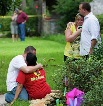 Neighbors embrace as word of Wednesday's shooting spreads in their Spring neighborhood. Seven people were shot, six fatally. The lone survivor was described as a 15-year-old girl. Photo: Brett Coomer, Staff / © 2014 Houston Chronicle