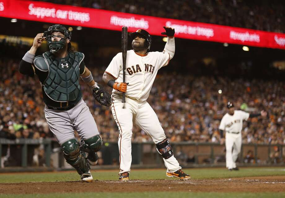 Pablo Sandoval waves home Brandon Crawford for the Giants' final run as catcher Derek Norris gives chase to Eric O'Flaherty's wild pitch in the sixth inning. Photo: Beck Diefenbach, Special To The Chronicle