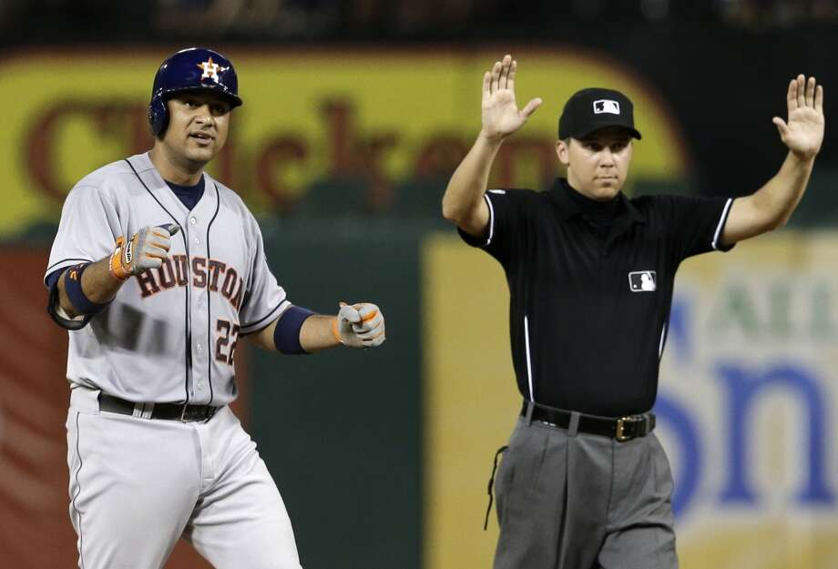 July 9: Astros 8, Rangers 4  Carlos Corporan celebrates on second base as umpire Chad Fairchild signals time after Corporan hit a two-run scoring double in the sixth inning. Photo: Tony Gutierrez, Associated Press
