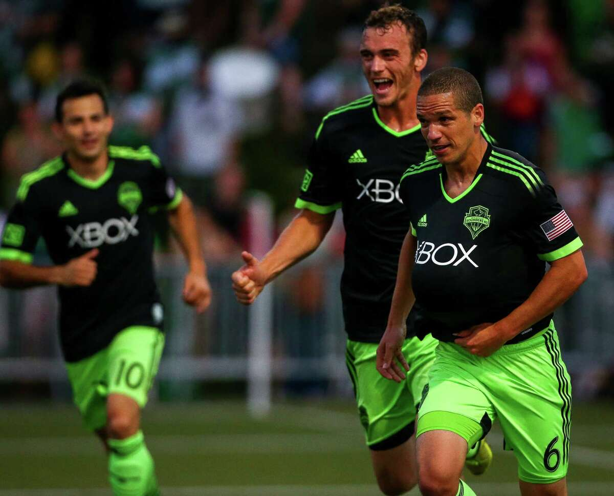 The Seattle Sounders celebrate after a goal by midfielder Osvaldo Alonso (6) during the Lamar Hunt U.S. Open Cup Quarterfinals match between Seattle Sounders FC and the Portland Timbers on Wednesday, July 9, 2014. The Sounders won the match 3-1.