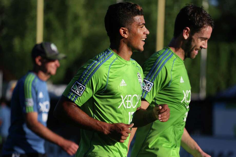 DeAndre Yedlin shares a laugh as he heads off the pitch prior to the Lamar Hunt U.S. Open Cup Quarterfinals match between Seattle Sounders FC and the Portland Timbers on Wednesday, July 9, 2014. The Sounders won the match 3-1. Photo: JOSHUA BESSEX, SEATTLEPI.COM / SEATTLEPI.COM