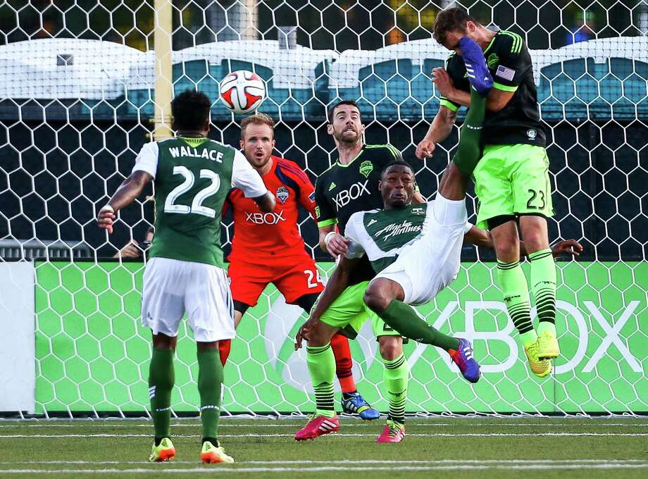 A corner near the Sounder's net ends with a kick to the face for Forward Cam Weaver (23) during the Lamar Hunt U.S. Open Cup Quarterfinals match between Seattle Sounders FC and the Portland Timbers  on Wednesday, July 9, 2014. The Sounders won the match 3-1. Photo: JOSHUA BESSEX, SEATTLEPI.COM / SEATTLEPI.COM
