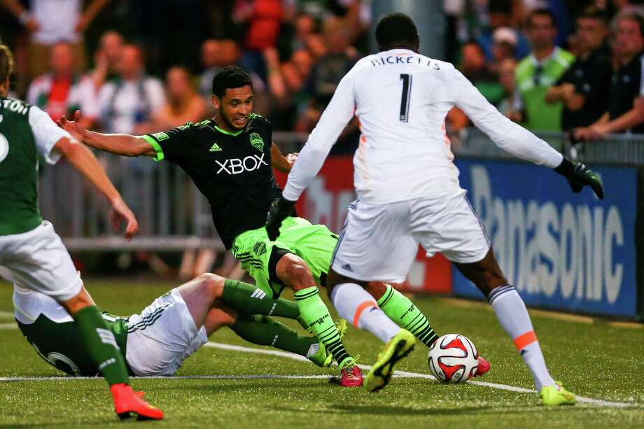 Lamar Neagle loses his balance while taking a shot during the Lamar Hunt U.S. Open Cup Quarterfinals match between Seattle Sounders FC and the Portland Timbers on Wednesday, July 9, 2014. The Sounders won the match 3-1. Photo: JOSHUA BESSEX, SEATTLEPI.COM / SEATTLEPI.COM