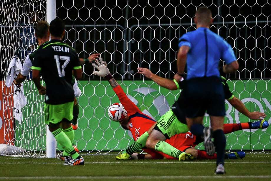 Seattle's Stefan Frei dives to make a save during the Lamar Hunt U.S. Open Cup Quarterfinals match between Seattle Sounders FC and the Portland Timbers on Wednesday, July 9, 2014. The Sounders won the match 3-1. Photo: JOSHUA BESSEX, SEATTLEPI.COM / SEATTLEPI.COM