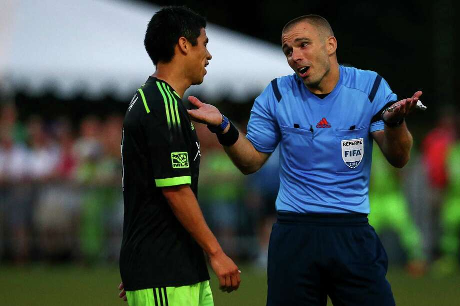 The official reacts to a complaint by Gonzalo Pineda (left) during the Lamar Hunt U.S. Open Cup Quarterfinals match between Seattle Sounders FC and the Portland Timbers on Wednesday, July 9, 2014. The Sounders won the match 3-1. Photo: JOSHUA BESSEX, SEATTLEPI.COM / SEATTLEPI.COM