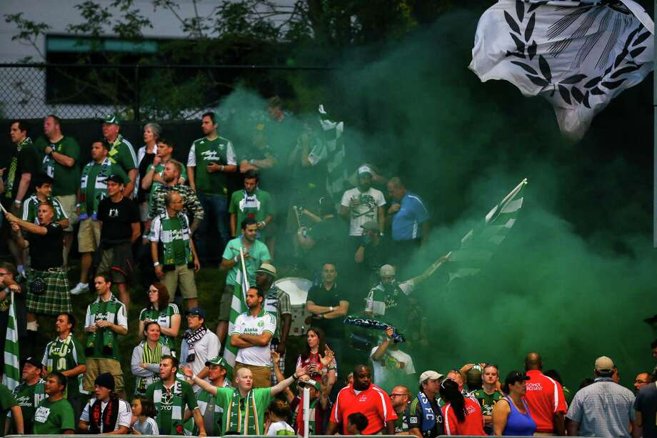 Timbers fans light smoke grenades during the Lamar Hunt U.S. Open Cup Quarterfinals match between Seattle Sounders FC and the Portland Timbers on Wednesday, July 9, 2014. The Sounders won the match 3-1. Photo: JOSHUA BESSEX, SEATTLEPI.COM / SEATTLEPI.COM